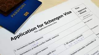 The decision to grant a visa. Pen voting approved in checkbox in blank Schengen Visa application form with passport and pen. Document with passport, apply and permission for foreigner country