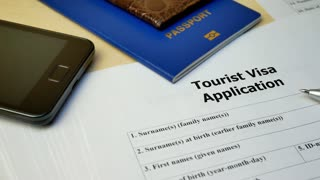 Tourist Visa application form with passport and pen. Document with passport, apply and permission for foreigner country