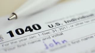 US Individual Income Tax Return Form 1040 with Pen in 2017