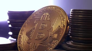 Virtual Coins BTC or Bit Coin, the new virtual internet Cryptocurrency, rotating with backlighting