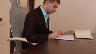 Businessman in suit at the table,when he fails to meet his target