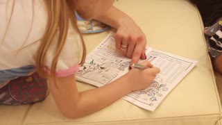child performs the task in a notebook