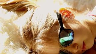 Cutie girl sun glasses on the beach