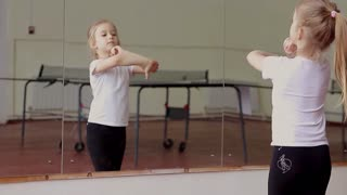 Little girl fun dancing training exercise in front of mirror