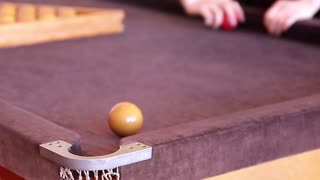 Red ball girl playing billiard.