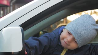 A little baby driving car.