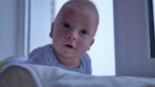 Baby boy holding his head