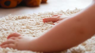 baby's hands on a fluffy carpet