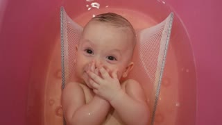 Bath for babies, baby wash your hair. Happy boy taking a bath.