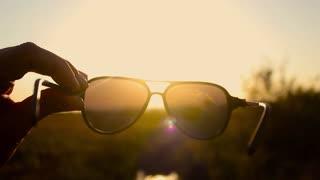 Beautiful sunset through sunglasses