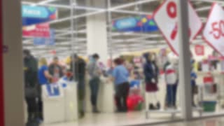 blurred image of people in shopping mall