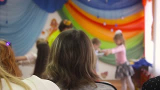Children sing the song on the stage when parents watch. Theater in kindergarten. Russia
