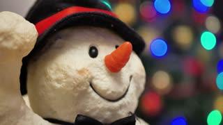 Christmas snowman decoration closeup. Soft focus of snowman,christmas tree background.