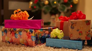 Close up of beautifully decorated Christmas tree and gifts. Holiday Christmas scene. Christmas gifts under the Christmas tree.