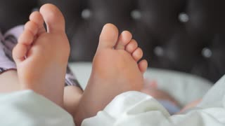 Close up on a baby feet in bed