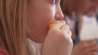 cute little girl eating orange