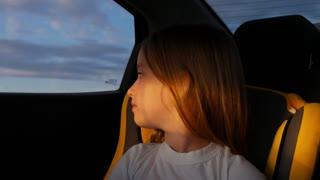 Cute little girl sitting in car seat.