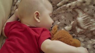 Cute sleeping child with teddy bear