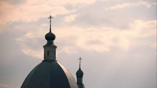 Dome of the church, clouds float in the sky. Timelapse.