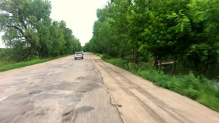 Driving a Car on a Country Road. POV, point of view front, day.