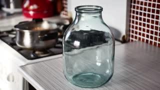 Empty vintage glass jar on kitchen table