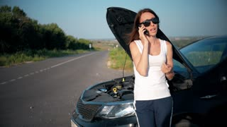 European business woman crashes car on the road, female motorist driver broken down on country road, use smartphone technology for help