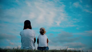 Family on grass with hands up and dream. Happy family concept, lifestyle, freedom.