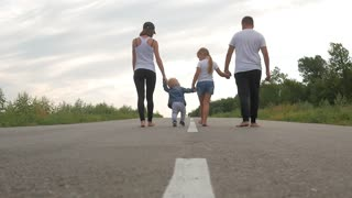 father and mother with children go on road in countryside, travel, tourism, hike and people concept