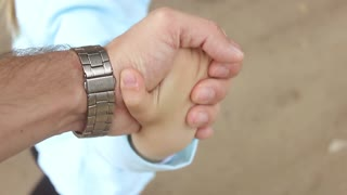 Father's hand lead his child daughter in summer forest nature outdoor, trust family concept.