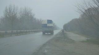 Fog on the road, a car.