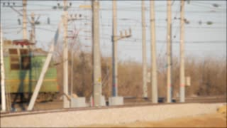 Freight train on the branch railway. Rail transportation. Blur effect. Heavy industry. Industrial conceptual scene with train.