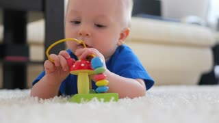 Funny little child playing with toys by the home