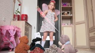 Funny little girl dancing in her room