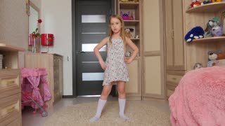 Funny little girl dancing in her room
