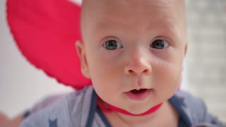 Funny toddler (boy) dressed as a superhero, close up portrait, superhero concept.