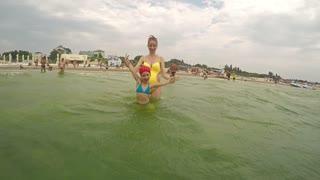 Girls enjoy sea bathing