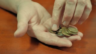 Hand the senior woman and pile coin for saving. money saving concept.