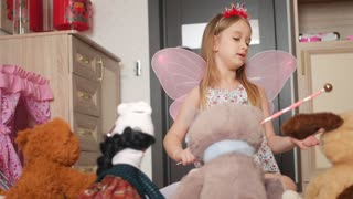 Happy Little Girl Plays with Plush Toys in Her Room.