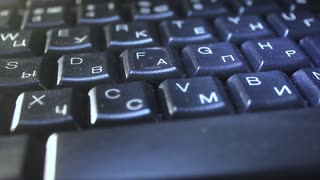 Keyboard close up with black keys.