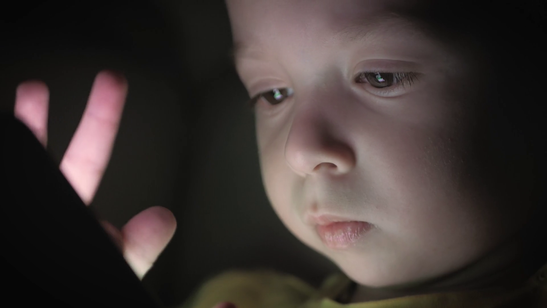 Little boy, sitting in a dark, playing with smartphone. Cute boy using a smartphone, resting on a the sofa. Stock Video Footage - Storyblocks