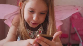 Little girl playing and touching a mobile phone