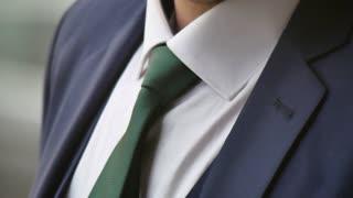 Man tying necktie, close up