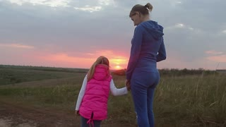 Mother and daughter happy in love at sunset. Mother's day. Happy family.