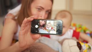 Mother and newborn baby doing selfie. Maternity concept. Parenthood. Motherhood Beautiful Happy Family Stock Video Footage.