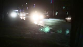 Night traffic city cars, headlight lights.