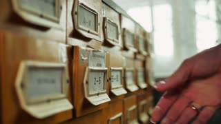 Old archive with wooden drawers. database concept. Vintage cabinet. library card or file catalog.