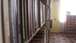 Old books in the Library of Russia. Old university library. Blurred Image many old books on bookshelf in library.