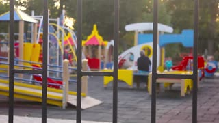 Outdoor playground in the park. Defocused and blurred image for background of children's playground,activities at public park.
