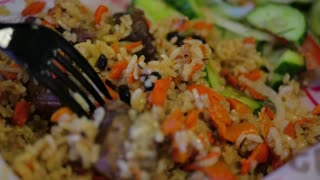 Pilaf with beef, carrots, onions, garlic, pepper and cumin. A traditional dish of Asian cuisine. Selective focus