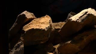 Pile of granite stones isolated on black background.